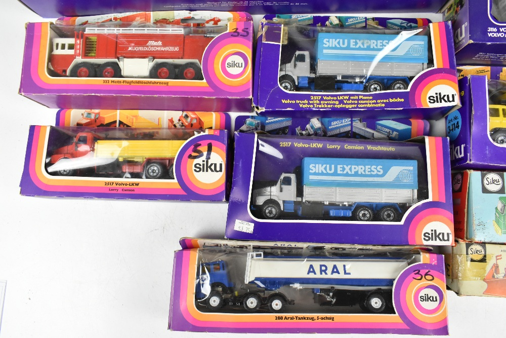 SIKU; fourteen boxed models including 3714 DBP-Paketlastzug Volvo F7, 3115 Volvo F12 LKW, 288 Aral- - Image 4 of 6