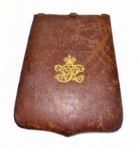 A Victorian maroon leather dispatches folder with gilt VR Royal cipher to front and pouch to