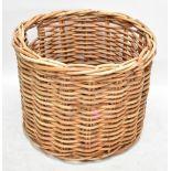 A large circular wicker log bin, 59cm x 76cm.Additional InformationSome wear through use but