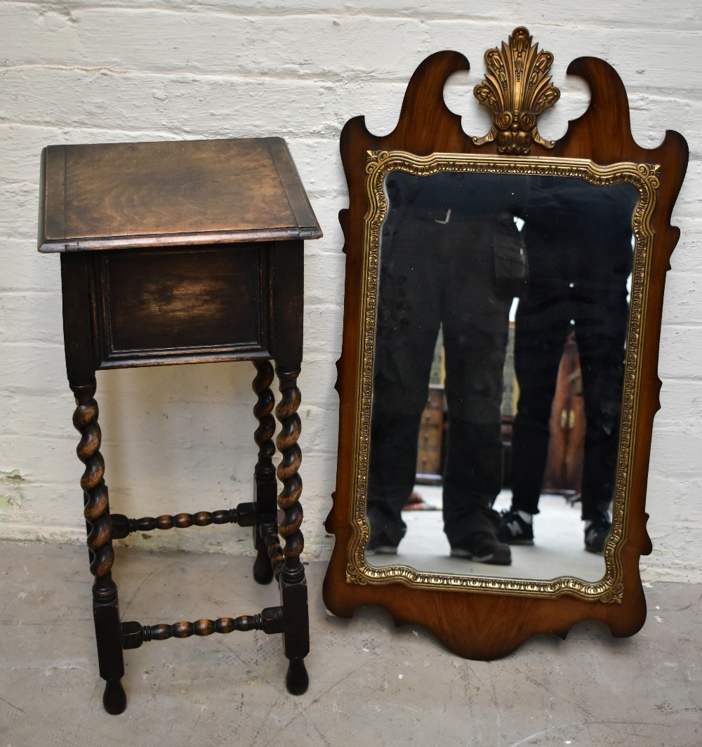 A 1920s oakjardinière stand with hinged box top on barleytwist legs,height 72cm,width 33cm,depth