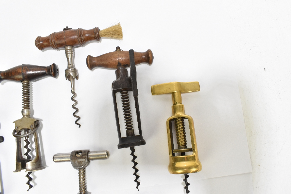 Ten corkscrews including Mister Punch, brass and three wooden handled examples (10).Additional - Image 5 of 5