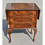 A reproduction walnut drop leaf chest, with three drawers on shell carved cabriole legs, height