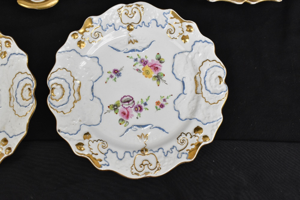 A pair of 19th century Ironstone china dessert plates with moulded floral detail throughout and - Image 5 of 8