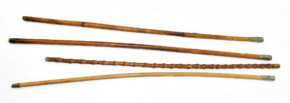 Four swagger sticks, three bearing crests to white metal mounts for 20th of Foot Lancashire
