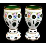 A pair of late 19th century Bohemian opaque flashed green glass vases, with cut detailing and