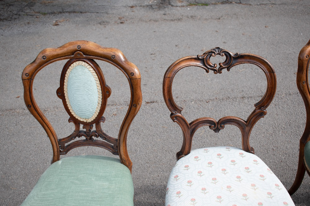 GILLOWS; a pair of Victorian carved rosewood side chairs, with scroll carved backs and floral - Image 2 of 4