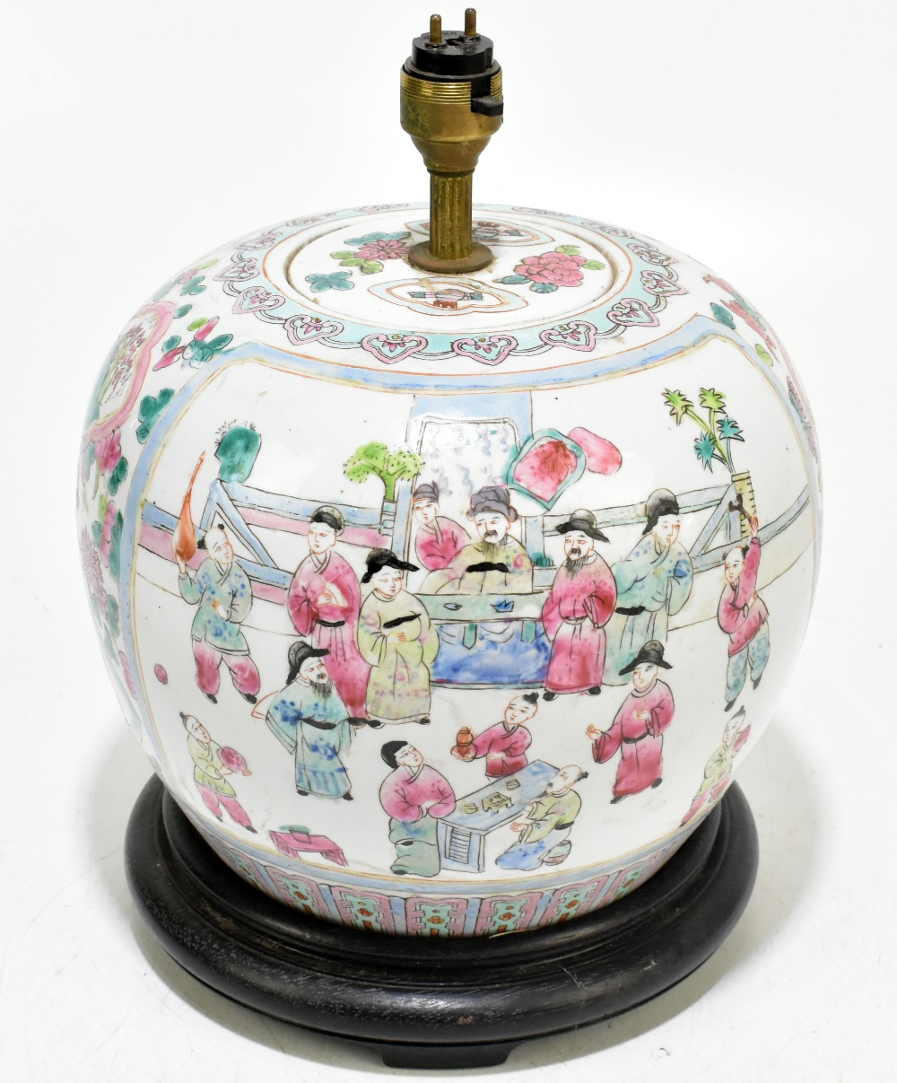 A Chinese Famille Rose ginger jar and cover of bulbous form, converted to a table lamp, decorated