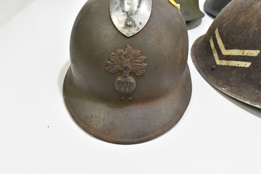 Six WWII and later helmets including a Brodie, American, French, further example labelled 'R' with - Image 2 of 13