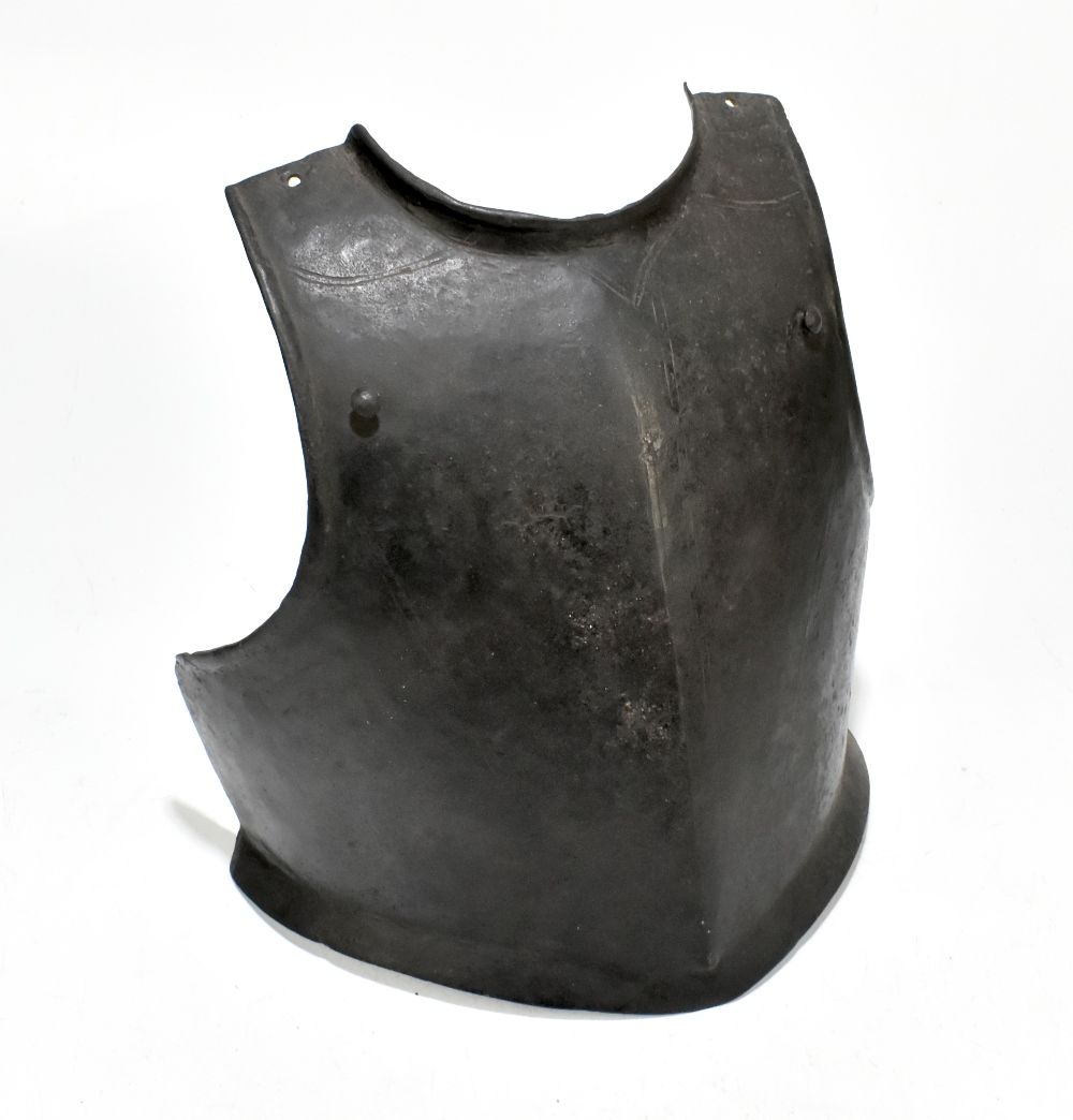 An English Cromwellian/Civil War period chest guard of heavy gauge bearing traces of chased