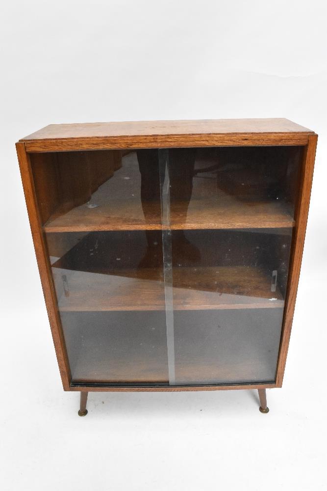 An oak bookcase with three sliding glass doors on castors, height 91cm, width 91.5cm, depth 22cm, - Image 4 of 6