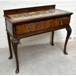 An early 20th century walnut serving table with inset marble top, with central drawer, raised on