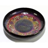 ROYAL DOULTON; an unusual flambé bowl of circular form with floral detail to the centre, diameter