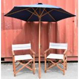 A pair of teak framed director's type chairs with coloured canvas backs and seats and a parasol (