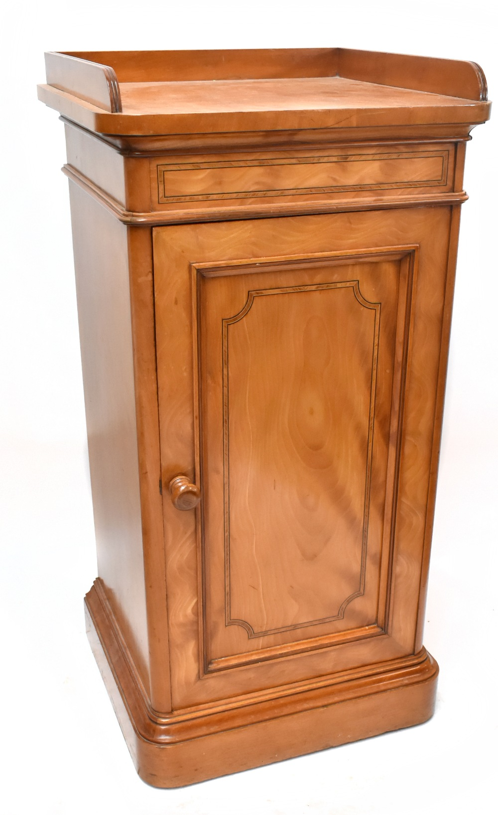 GILLOWS; a Victorian satin walnut and inlaid bedside cabinet with three-quarter raised gallery above