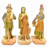 ROYAL WORCESTER; three figures emblematic of countries decorated in shot enamels and modelled by
