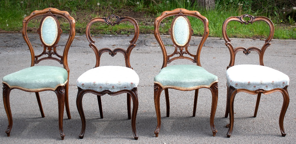 GILLOWS; a pair of Victorian carved rosewood side chairs, with scroll carved backs and floral