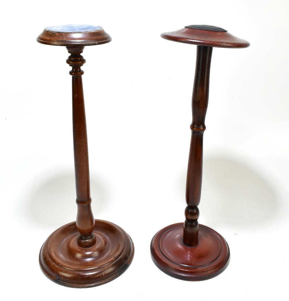 A late 19th century mahogany wig stand, raised on a circular column terminating on a circular plinth