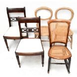A pair of late Georgian mahogany bar back dining chairs with drop-in seats raised on turned column