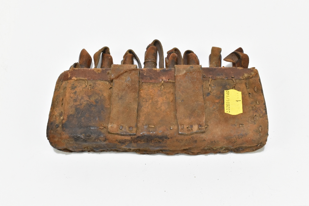 A 19th century leather eight section powder magazine, length 19.5cm. Provenance: The Captain Allan - Image 2 of 3
