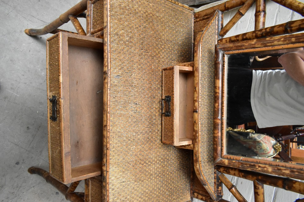 An early 20th century bamboo mirror back dressing table, with two drawers raised on column supports, - Image 5 of 7