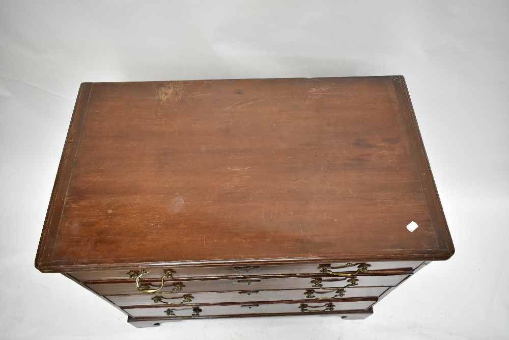 An early 19th century mahogany chest of drawers with brush slide above four drawers, raised on - Image 2 of 5