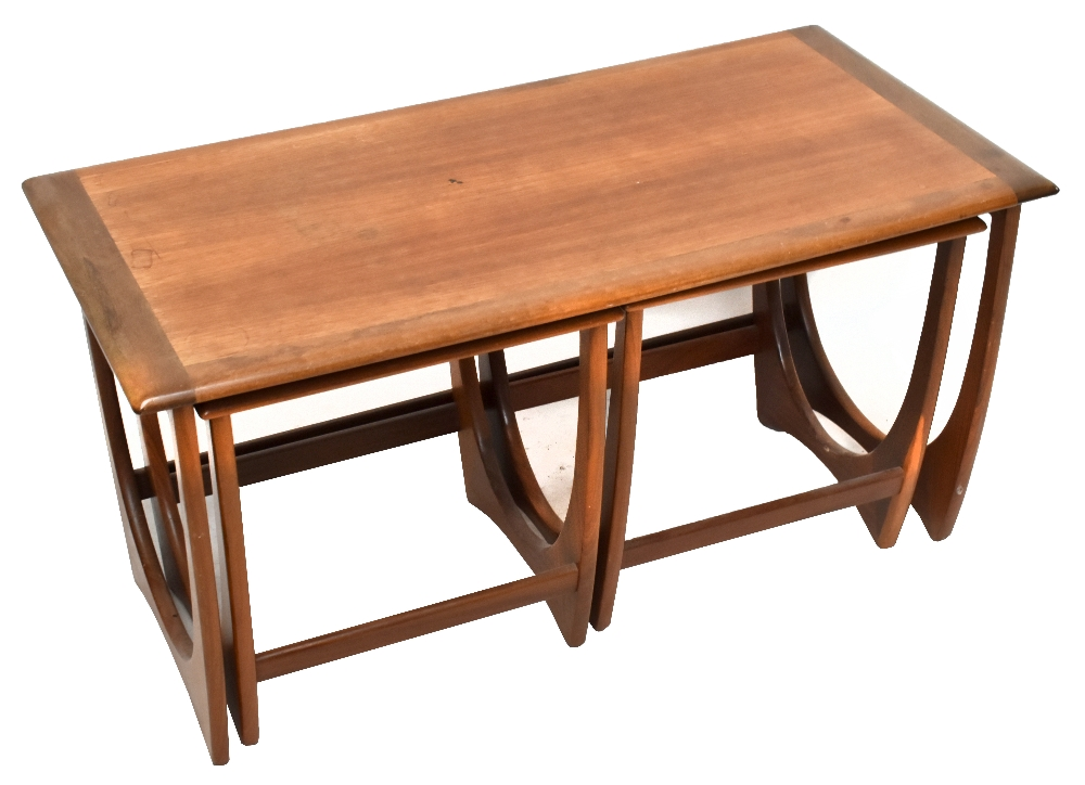 A G-plan teak nest of three coffee tables on shaped end supports, largest table height 51cm,width