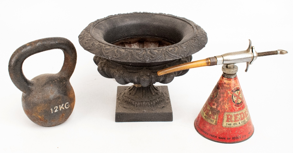 A cast iron pedestal urn, height 24cm, diameter 32cm, together with an iron 12kg dumbbell and