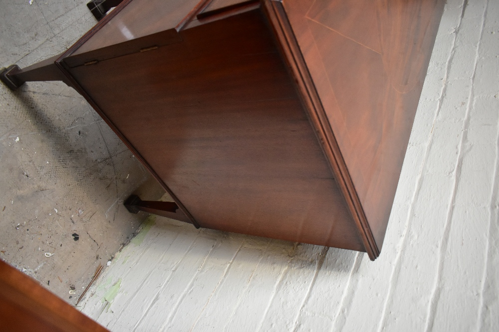 A Georgian inlaid mahogany sideboard, the large central drawer above carved arch shaped secret - Image 5 of 7