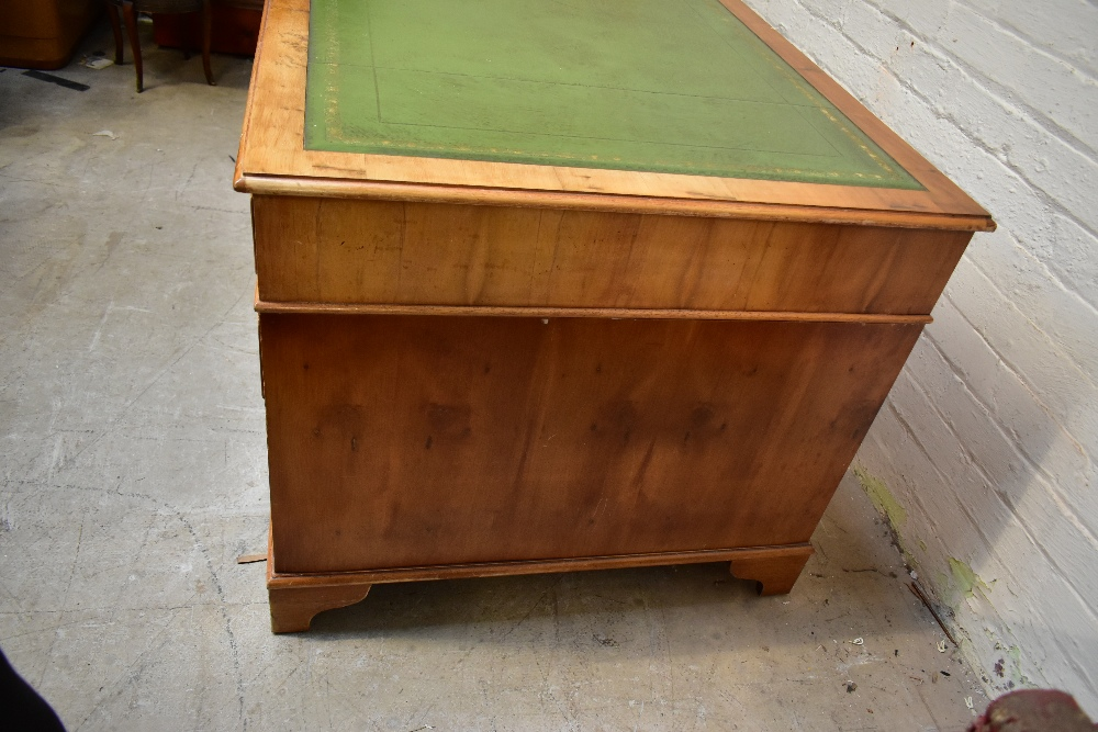 A reproduction yew wood pedestal desk, with green leather inset top above an arrangement of nine - Image 3 of 7