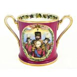 F&R PRATT WARE; a transfer printed loving cup, decorated in the The Redoubt Inkerman pattern, height