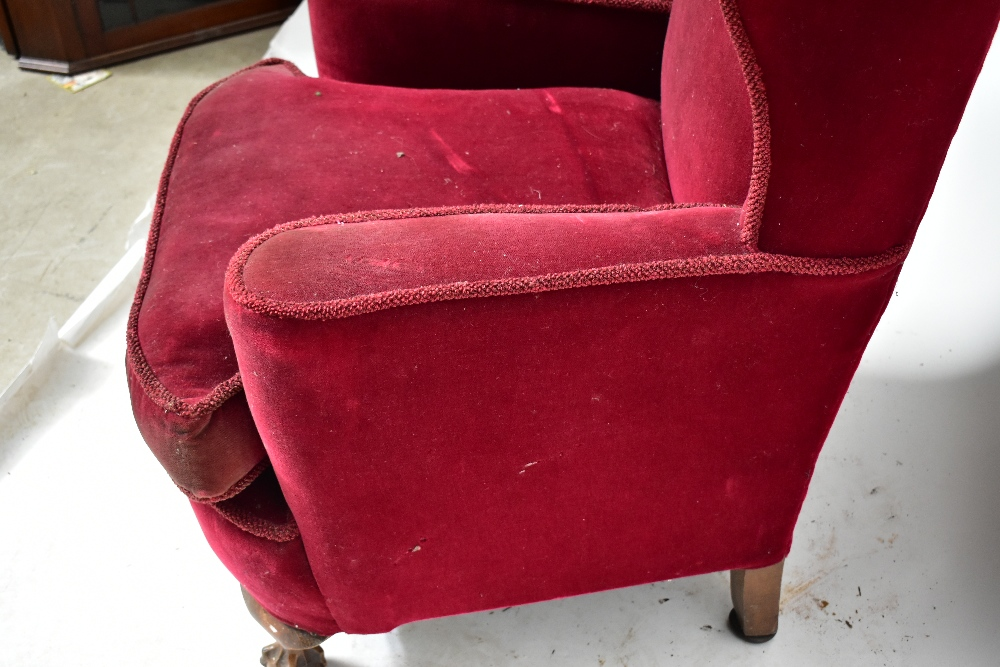 An early 20th century wingback armchair, upholstered in a red material, raised on ball and claw - Image 3 of 4