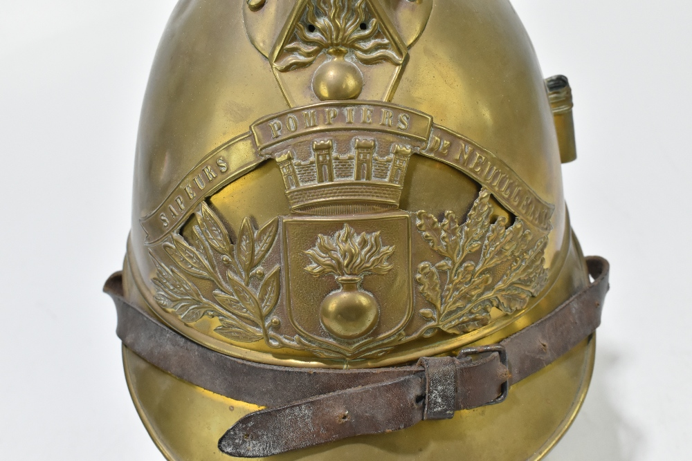 A French fireman's brass helmet with applied badge inscribed 'Sapeurs Pompiers De Neuille Le L.', - Image 5 of 6