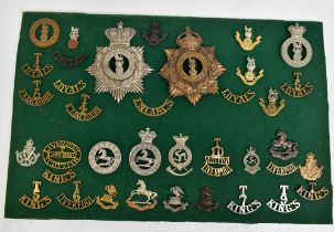 THE LOYAL NORTH LANCASHIRE REGIMENT; a good group of badges including two helmet/shako plates, a