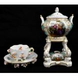 MEISSEN; a floral painted and encrusted teacup and saucer, both with underglaze blue cross sword