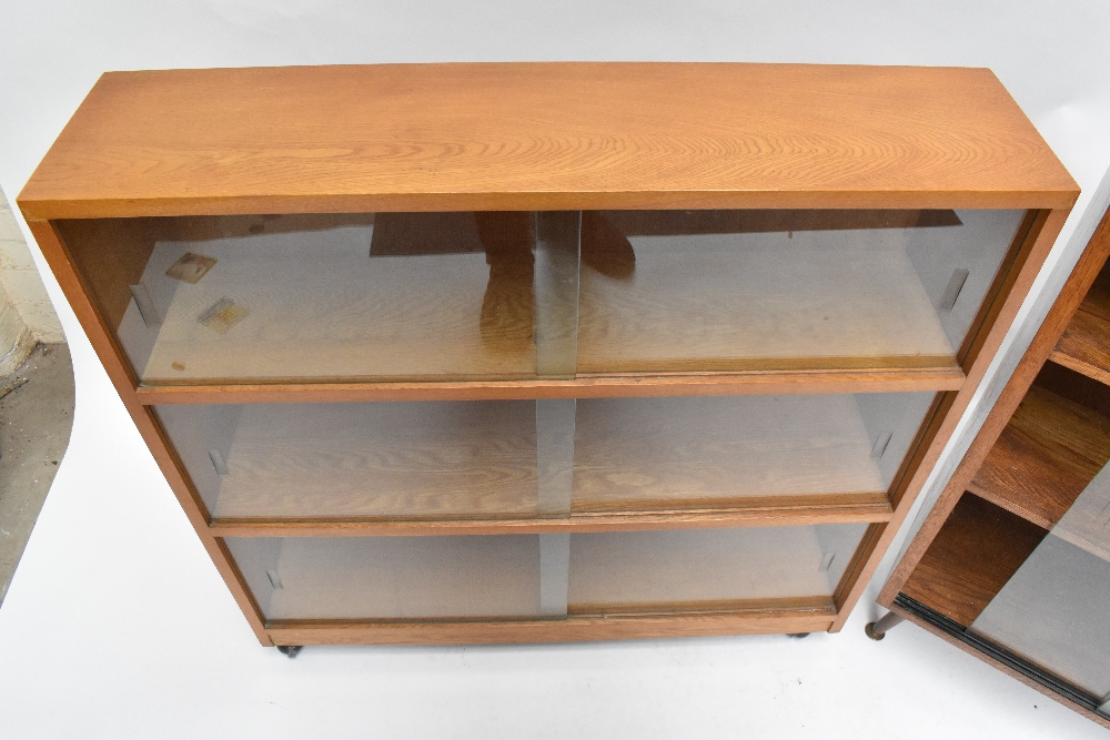 An oak bookcase with three sliding glass doors on castors, height 91cm, width 91.5cm, depth 22cm, - Image 3 of 6