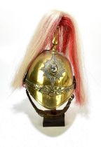 A 19th century brass cavalry trooper's helmet with badge, possibly for the Fifth Dragoon Guards,