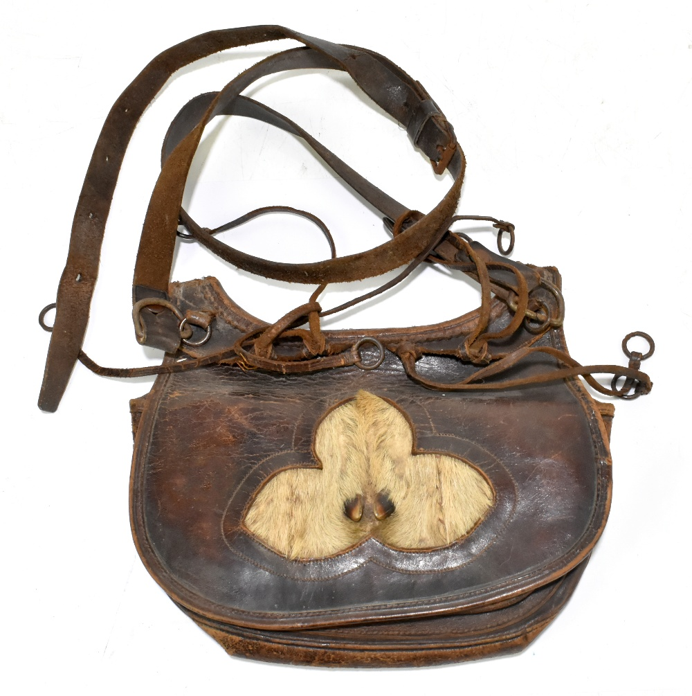 A leather cartridge pouch, approx 21 x 24cm. Provenance: The Captain Allan Marshall Collection.