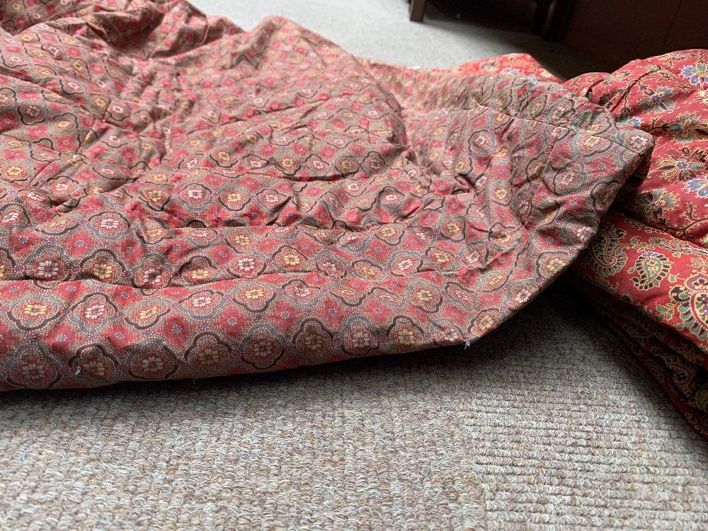 Two late Victorian quilted underskirts/winter petticoats, one decorated with a floral design against - Image 6 of 10