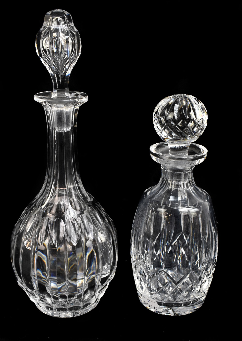 A 19th century cut glass decanter and stopper, the globular body cut with angular facets, with a