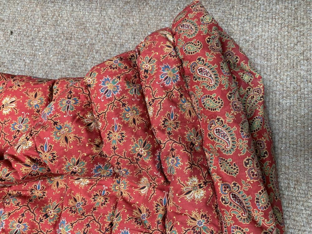 Two late Victorian quilted underskirts/winter petticoats, one decorated with a floral design against - Image 4 of 10