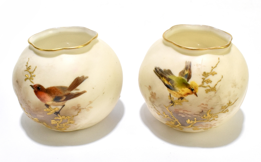 GRAINGER'S WORCESTER; a pair of globular vases painted with birds sitting upon gilt branches,