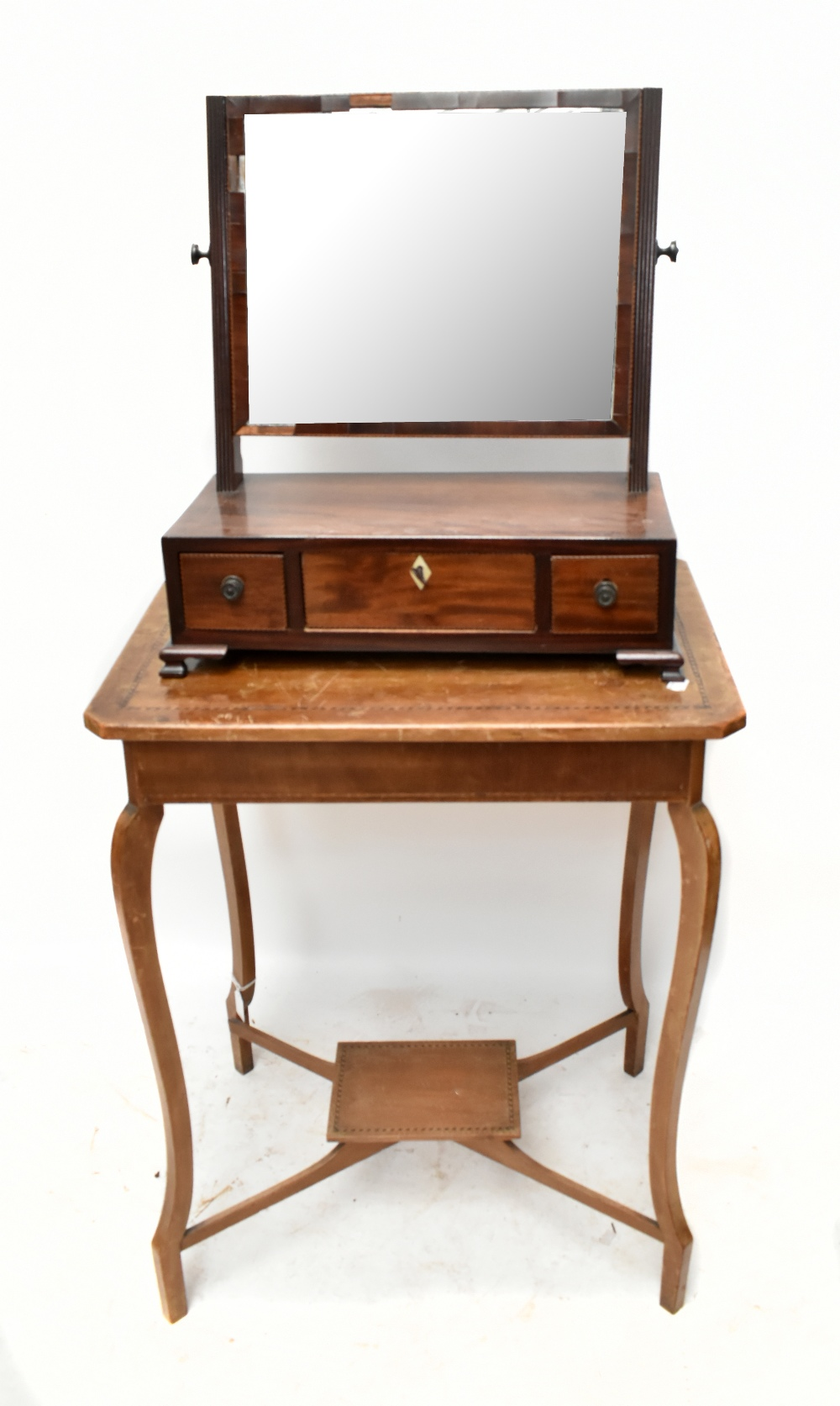 A 19th century mahogany dressing table mirror with three base drawers, raised on bracket feet,
