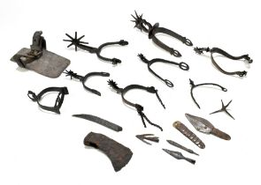 A group of antique steel and iron spurs and rowel spurs, some bearing decoration, a circa 12-14th