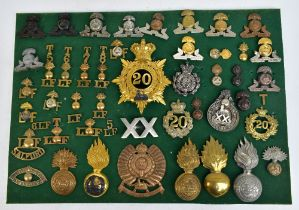 THE LANCASHIRE FUSILIERS; a good group of badges including a gilt helmet/shako plate for the 20th of