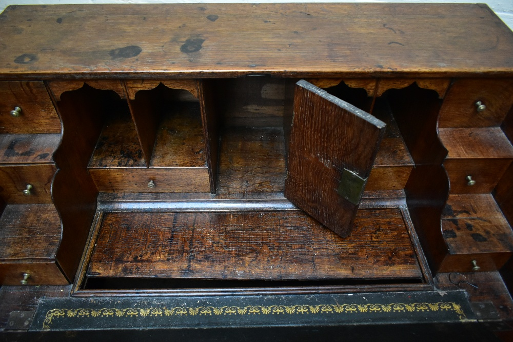A George III oak bureau withfall-front enclosing a fitted interior with eight drawers and four - Image 6 of 6