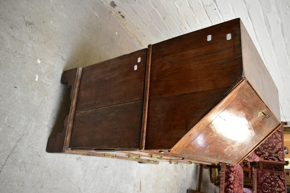 A George III oak bureau withfall-front enclosing a fitted interior with eight drawers and four - Image 2 of 6