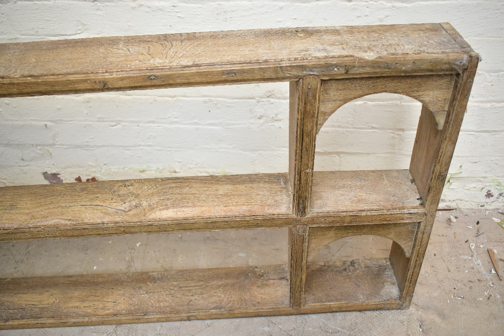A rustic limed oak hanging plate rack, with arched side sections, length 165cm, height 68cm. - Image 2 of 3