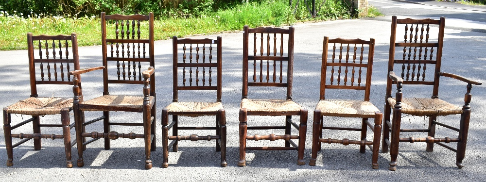 A matched set of six 19th century and later rush seated spindle back chairs, to include an elm