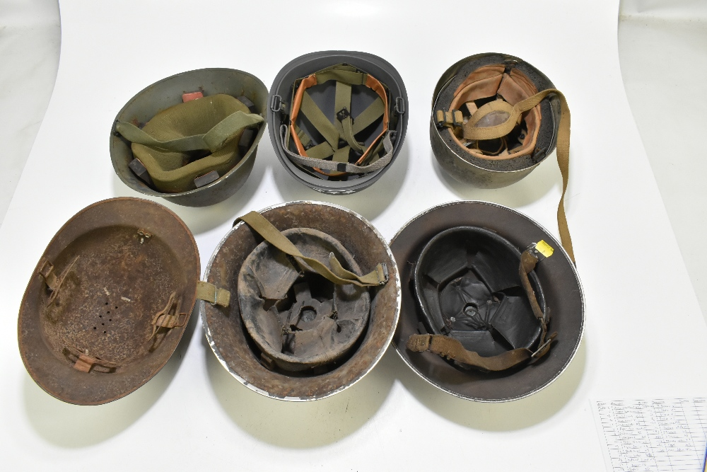 Six WWII and later helmets including a Brodie, American, French, further example labelled 'R' with - Image 6 of 13