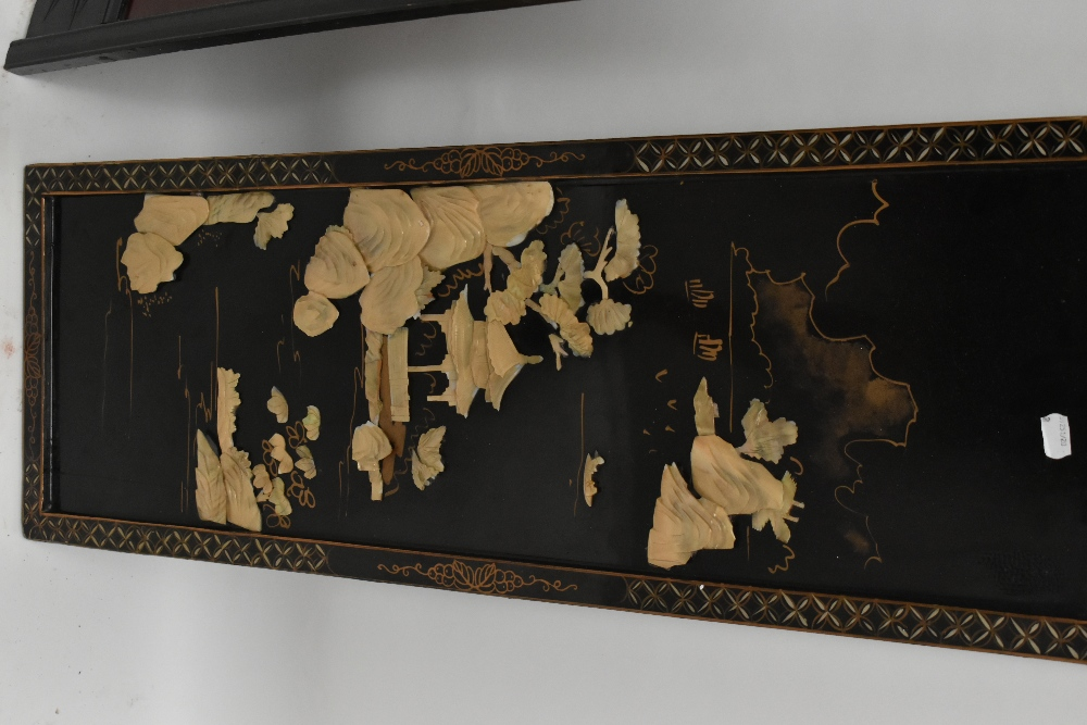 An early 20th century Chinese lacquered two division folding screen, the rectangular panels inlaid - Image 2 of 3